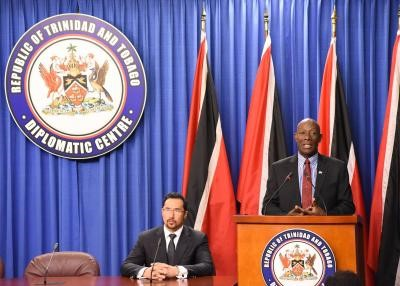 Prime Minister Dr Keith Rowley presides over a briefing with National Security Minister Stewart Young